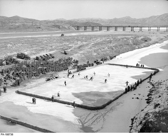 Members of the 2nd Battalion Royal Canadian Regiment play hockey at Imjin Gardens on Feb. 4, 1952. [GOVERNMENT OF CANADA]