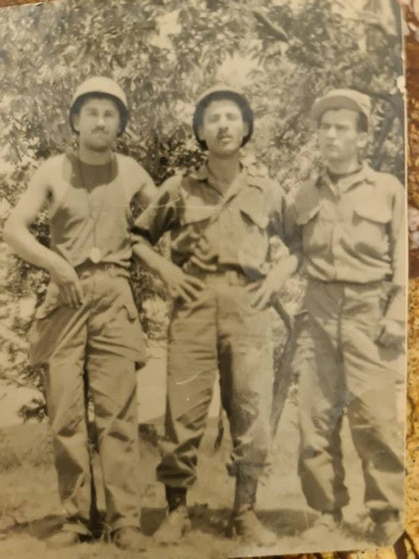 Mehmet Ziya Ozturk, center, in a photo taken during the Korean War. Ozturk was a communications officer for the Turkish brigade and arrived in October 1952 at the age of 21. [MEHMET ZIYA OZTURK]