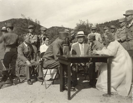 Seated second from right, President Syngman Rhee, at a so-called Freedom Village near the border, a village in South Korea created by the United Nations to greet repatriated soldiers from the North, on Feb. 19, 1952. [ICRC]