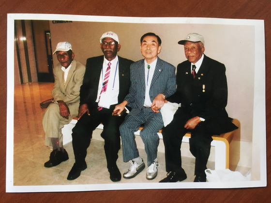 Debela, far right, with Sintayehu, second from right, during their meeting in Korea in 2010. [MELESSE TESSEMA DEBELA]