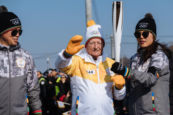 Charland when he revisited in 2018 carrying a torch in a relay for the PyeongChang Olympics in Gangwon. [CLAUDE CHARLAND]