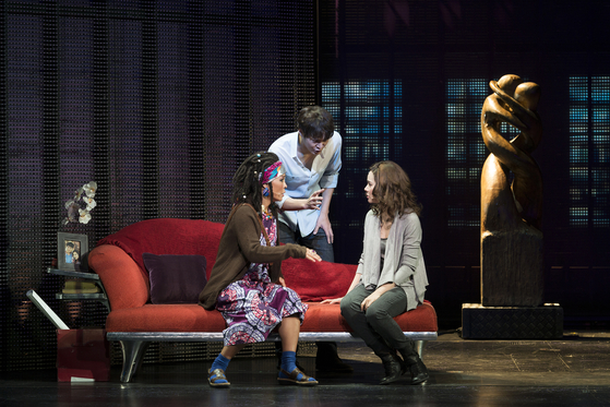 Choi Jeong-won, left, playing Oda Mae Brown, Joo Won, center, playing Sam, and Ivy, right, playing Molly, all performed for the premier of the musical in 2013. [SEENSEE COMPANY]