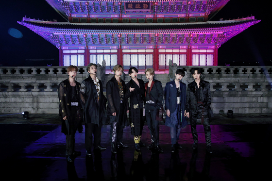 """This photo, provided by Big Hit Entertainment on Sept. 29, 2020, shows K-pop group BTS posing for a photo in front of Geunjeongjeon Hall of Gyeongbok Palace in Seoul, South Korea, where the band filmed a performance for the """"BTS Week"""" special on NBC's """"The Tonight Show Starring Jimmy Fallon"""" in the United States. [BIG HIT ENTERTAINMENT]"""