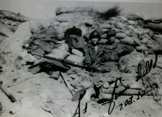 Park Moon-joon, the man wearing a helmet, in this photo taken on Oct. 7, 1952, near the site of the Battle of Arrowhead Ridge in Gangwon. [PARK MOON-JOON]