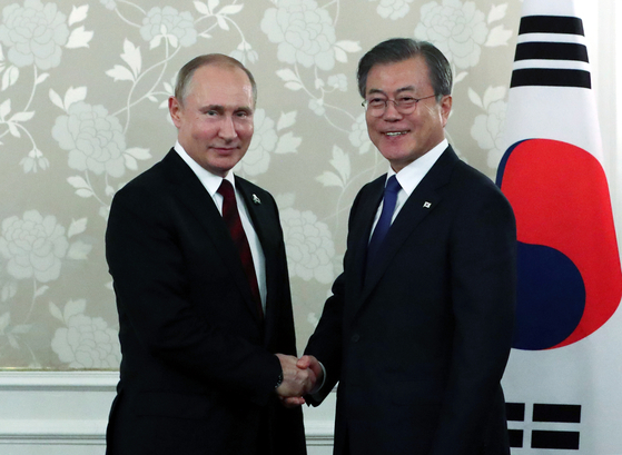 President Moon Jae-in and Russian President Vladimir Putin shake hands before their summit in Osaka on June 29, 2019 on the sidelines of the G20 Summit in Japan.  [JOINT PRESS CORPS]