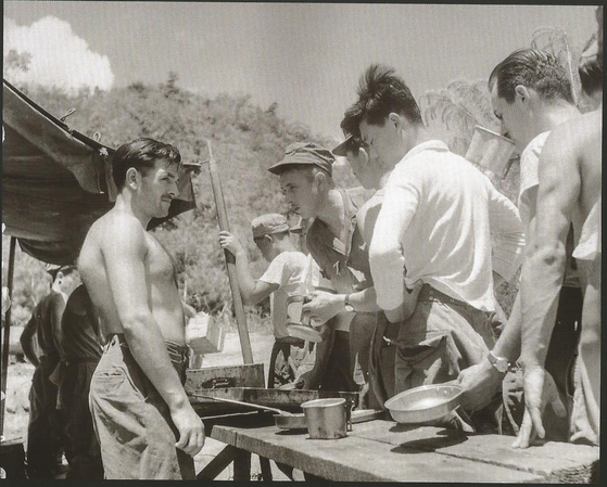 Members of the French Battalion receiving their rations near the site of the Battle of T-Bone in 1952. The photo has been provided by Ecpad to the French Embassy in Seoul. [ECPAD/GABRIEL APPAY]