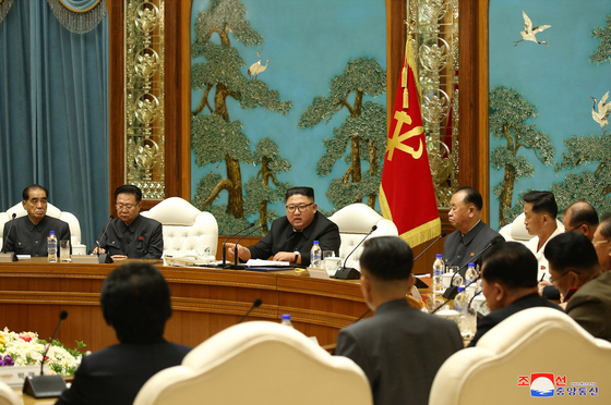 North Korean leader Kim Jong-un, center, presides over a political bureau meeting of the Workers' Party Central Committee on Monday. [YONHAP]