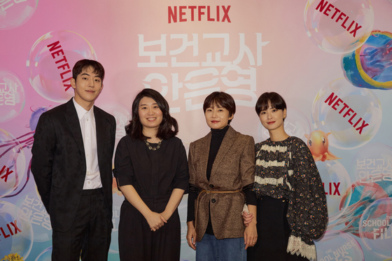 """From left, actor Nam Joo-hyuk, author Chung Se-rang, director Lee Kyoung-mi and author Jung Yu-mi pose for a photo at an online press event for the upcoming Netflix series """"The School Nurse Files"""" held on Thursday. [NETFLIX]"""