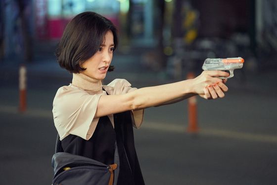 Eun-young holds out the BB Gun for protection. [NETFLIX]