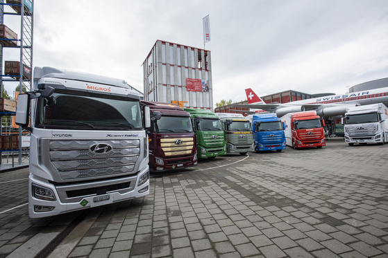 Seven units of Hyundai Motor's Xcient Fuel Cell that were exported to Switzerland are parked in front of the Swiss Museum of Transport in Luzern on Oct. 7. [HYUNDAI MOTOR]