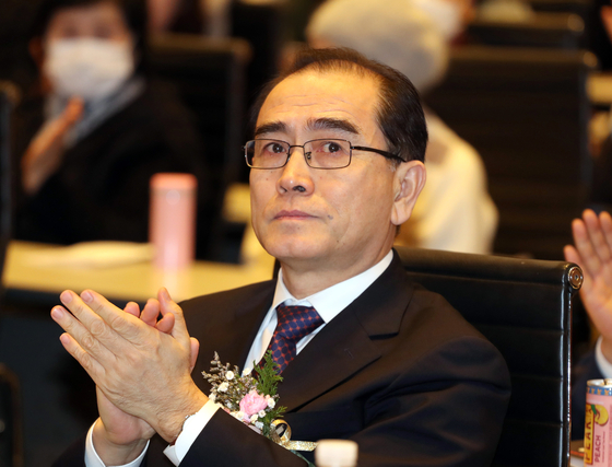 Rep. Thae Yong-ho, North Korea's former deputy ambassador to Britain, claps at a political event in February. [YONHAP]