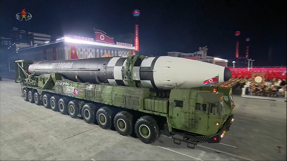 A new type of intercontinental ballistic missile (ICBM) paraded on an 11-wheeled transporter erector launcher during a military parade in Pyongyang's Kim Il Sung Square on Saturday, the 75th anniversary of the North's ruling Workers' Party. [YONHAP]