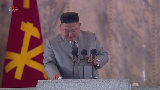 North Korean leader Kim Jong-un tears up while delivering his speech at the military parade on Saturday, in footage released by Korean Central Television. [YONHAP]