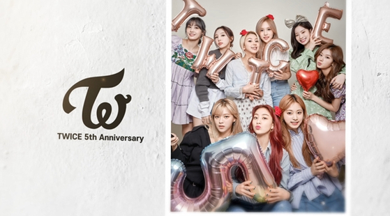 Girl group Twice celebrates its upcoming fifth anniversary with a new family photo. [JYP ENTERTAINMENT]