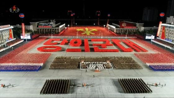"""A scene from Saturday's military parade in Kim Il Sung Square, Pyongyang, with participants holding placards that together read """"Army of the [Workers'] Party."""" [YONHAP]"""