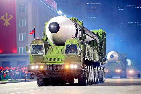 A new type of intercontinental ballistic missile (ICBM) paraded on an 22-wheeled transporter erector launcher during a military parade in Pyongyang's Kim Il Sung Square on Saturday, the 75th anniversary of the North's ruling Workers' Party. [NEWS1]