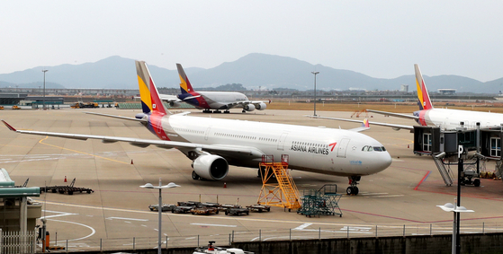 An Asiana Airlines plane is parked at Incheon International Airport on Monday. [NEWS1]