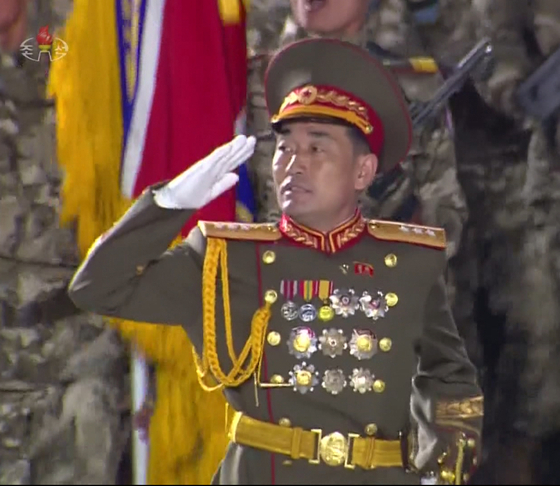 Gen. Kim Jong-gil, North Korea's new head of the Strategic Force, marching with troops in a military parade on Saturday as seen in footage from the official Korean Central Television. [YONHAP]