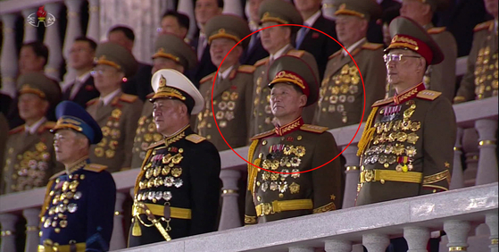 Gen. Pang Doo-seob, circled in red, North Korea's new chief of the General Staff Operations Bureau, featured with top military commanders during Saturday's military parade in footage from KCTV. [YONHAP]