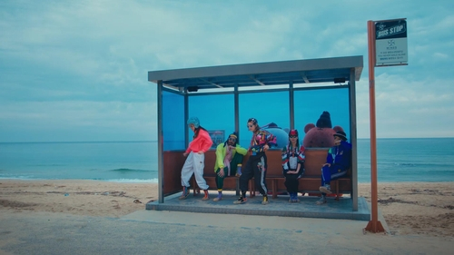 """This photo, provided by the Korea Tourism Organization, shows a screenshot of its tourism promotion video on the Korean coastal city of Gangneung, Gangwon. The bus station is the filming location for K-pop superstar BTS's music video """"Spring Day."""" [KTO/YONHAP]"""