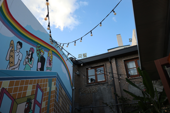 One corner from Bukseong-ro adorned with lights and a mural. [LEE SUN-MIN]
