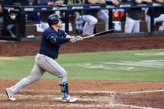 Choi Ji-man of the Tampa Bay Rays hits a solo home run against the Houston Astros during the eighth inning in Game 5 of the American League Championship Series at Petco Park in San Diego on Thursday. [AFP/YONHAP]