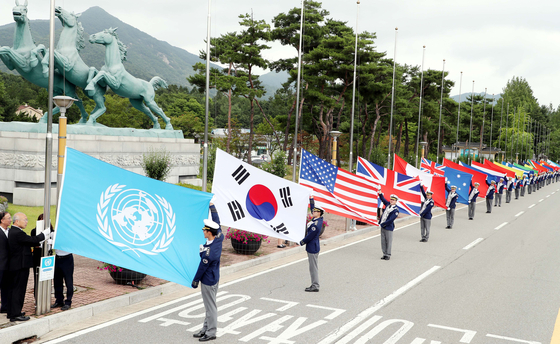 Flags of the United Nations and the countries that fought as part of the UN forces during the Korean War (1950-1953) are hoisted at the Daejeon National Cemetery in June 2019 to honor veterans. [KIM SUNG-TAE]