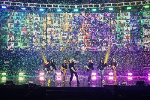Fans' faces appear behind BTS during the BTS Map of the Soul ON:E concert on Saturday. [BIG HIT ENTERTAINMENT]