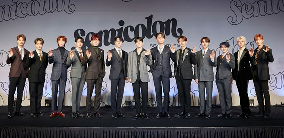 """Boy band Seventeen poses for photos prior to the online press conference held on Monday afternoon for the release of its special album """"; [Semicolon]."""" [PLEDIS ENTERTAINMENT]"""
