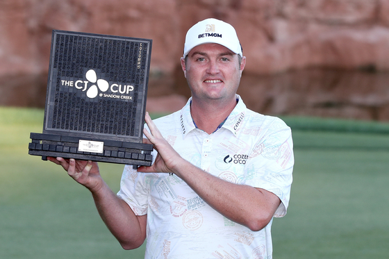Jason Kokrak of the United States poses for a photo with the trophy after wining the CJ CUP @ SHADOW CREEK in Las Vegas, Nevada on Sunday. [GETTY IMAGES FOR THE CJ CUP]
