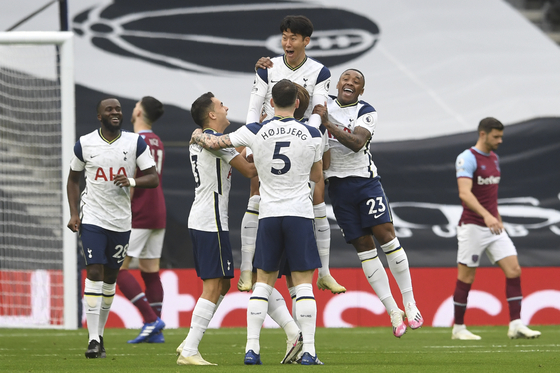 Son Heung-min of Tottenham Hotspur, center, celebrates after scoring a goal during a Premier League match against West Ham United at Tottenham Hotspur Stadium in London, England, on Sunday. [AP/YONHAP]