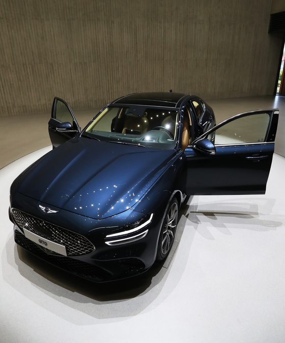 The long-awaited Genesis' The New G70 is unveiled in Yongin, Gyeonggi, on Tuesday. The latest G70 midsize luxury sedan, which made its official debut in 2017, retails starting at 40.35 million won ($35,000). [YONHAP]