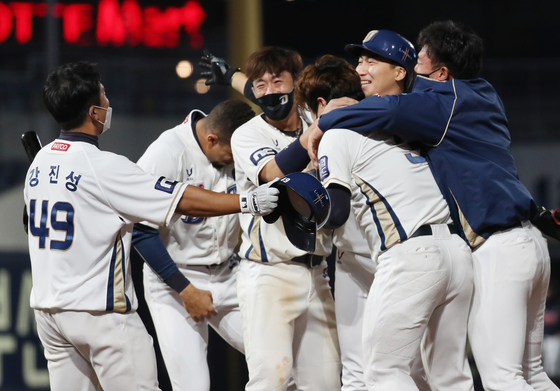 The NC Dinos celebrate after picking up a thrilling 6-5 victory against the Lotte Giants at Changwon NC Park in Changwon, South Gyeongsang on Friday. [YONHAP]