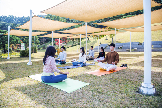 People meditate at Forest Camp. [EVERLAND]
