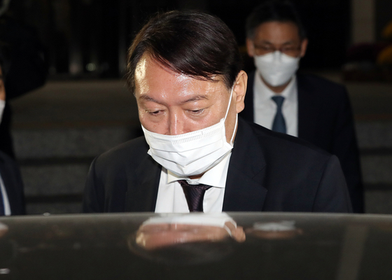 Prosecutor General Yoon Seok-youl leaves the National Assembly after a 15-hour audit of the Supreme Prosecutors' Office. [YONHAP]