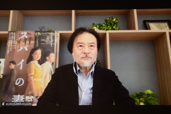 Director Kiyoshi Kurosawa participates at an online press event Monday for the 25th Busan International Film Festival, in which his film was invited for a gala screening. [2020 BIFF]