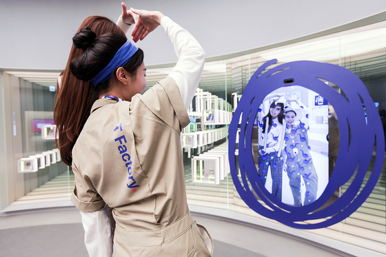 An employee demonstrates an augmented reality mirror at T Factory, an experience zone run by SK Telecom in western Seoul.