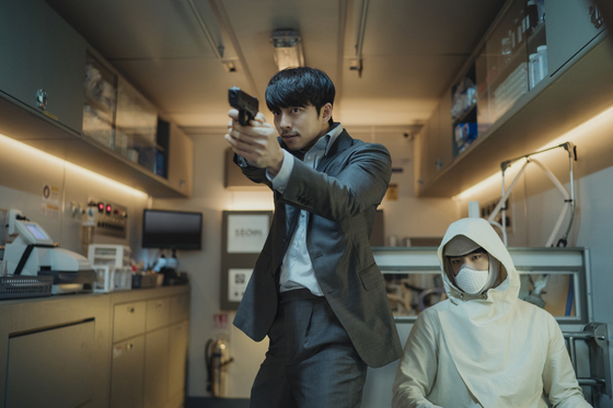 Gi-heon, played by Gong Yoo, is an ex-agent of the intelligence bureau on his last mission to transport Seobok, played by Park Bo-gum, the world's first-ever human clone, to safety. [CJ ENTERTAINMENT]