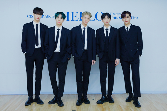 "Boy band CIX poses for a photo during an online showcase held on Tuesday afternoon for its third EP ""Hello Chapter 3. Hello, Strange Time."" From left are members Hyunsuk, BX, Bae Jin-young, Yonghee and Seunghun. [C9 ENTERTAINMENT]"