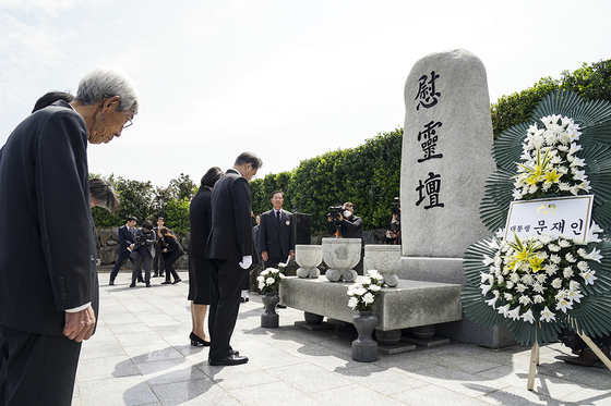 President Moon Jae-in and First Lady Kim Jung-sook bow their heads down on April 3, 2020, at the Jeju Massacre Memorial in Jeju Island. [NEWS1]