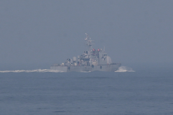 A South Korean Navy ship searches for the body of a fisheries official shot and killed by the North last month in the waters near the Soyeonpyeong Island on Oct. 19, 2020.  [YONHAP]