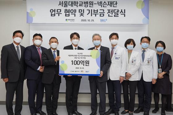 Representatives from Nexon Foundation, Neople, NXC and Seoul National University Hospital at the ceremony held on Thursday. [NEXON]
