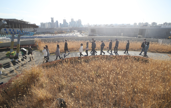 Visitors walk in a rooftop park atop the Central Government Complex in Sejong City on Monday. The park was closed for months due to the coronavirus pandemic.