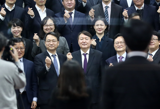 Prosecutor General Yoon Seok-youl, third from left in the front row, poses with prosecutors during a visit to a new prosecutors' training center in Jincheon, North Chungcheong, on Tuesday. [YONHAP]