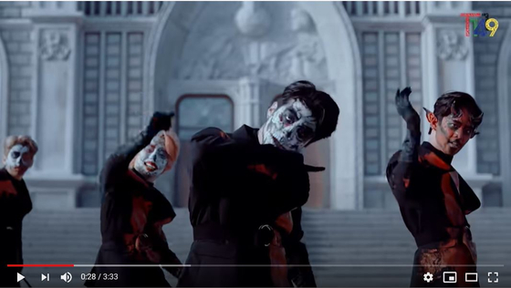 """T1419 members wearing face paint in their """"Dracula"""" music video. [SCREEN CAPTURE]"""