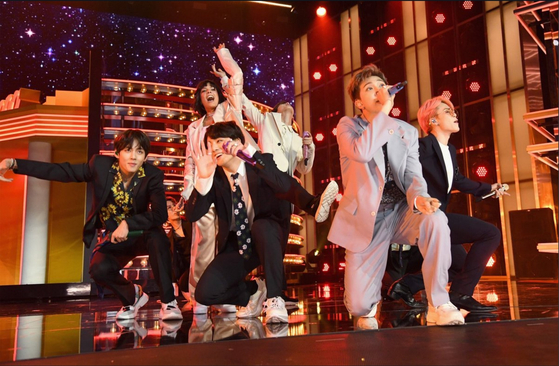 Boy band BTS member Jungkook, second from left, performs wearing Andersson Bell's sneakers during the Billboard Music Awards last year. [ANDERSSON BELL]