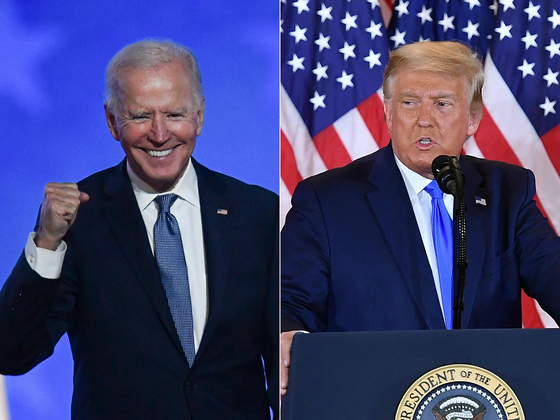 Democratic presidential nominee Joe Biden, left, speaks during election night at the Chase Center in Wilmington, Delaware, and U.S. President Donald Trump, right speaks during election night in the East Room of the White House in Washington early Wednesday after polls closed across the United States Tuesday. [AFP/YONHAP]