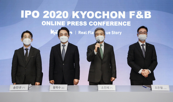 Executives from Kyochon F&B attend a press conference ahead of its initial public offering in October. [KYOCHON F&B]