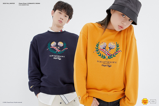 Models pose with fashion brand Romantic Crown's sweatshirts made in collaboration with Spanish confectionery company Chupa Chups. [MUSINSA]