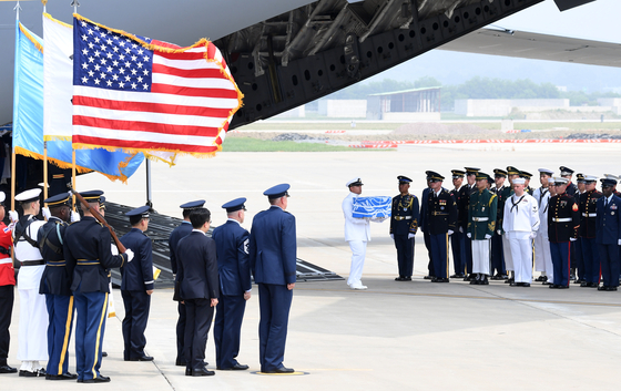 Remains of American troops arriving from North Korea to Osan, Gyeonggi, South Korea, in June 2018, after North Korea agreed to send the remains in commemoration of the 65th anniversary of the signing of the armistice that ended the Korean War. [JOINT PRESS CORPS]